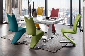 Essgruppe Tisch Manhattan Hochglanz weiß 6 x Schwingstuhl Amado verschiedenfarbig